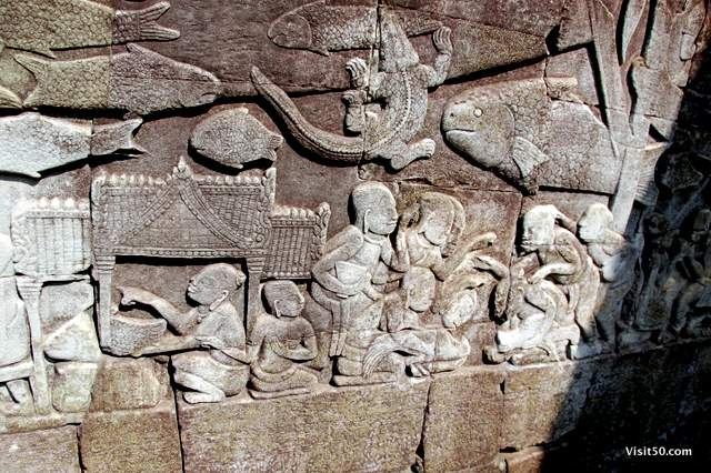 scene from the outer gallery at the Bayon temples. Our guide said itshows Chinese expats negotiating with Khmer merchants at an Angkorean market.